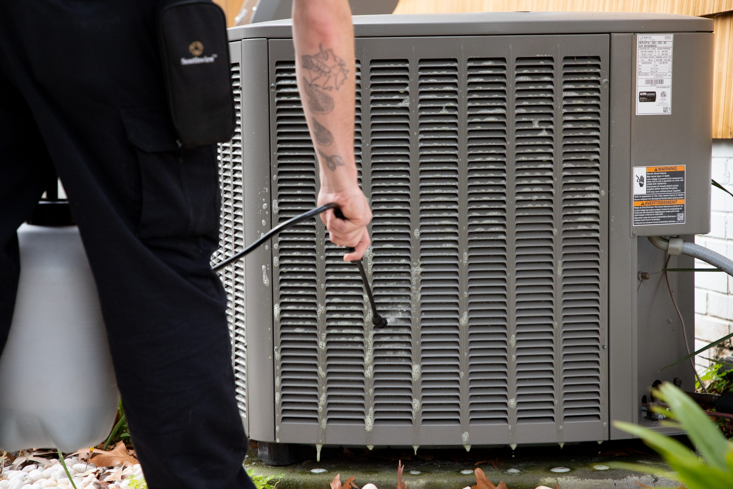 technician cleaning hvac system