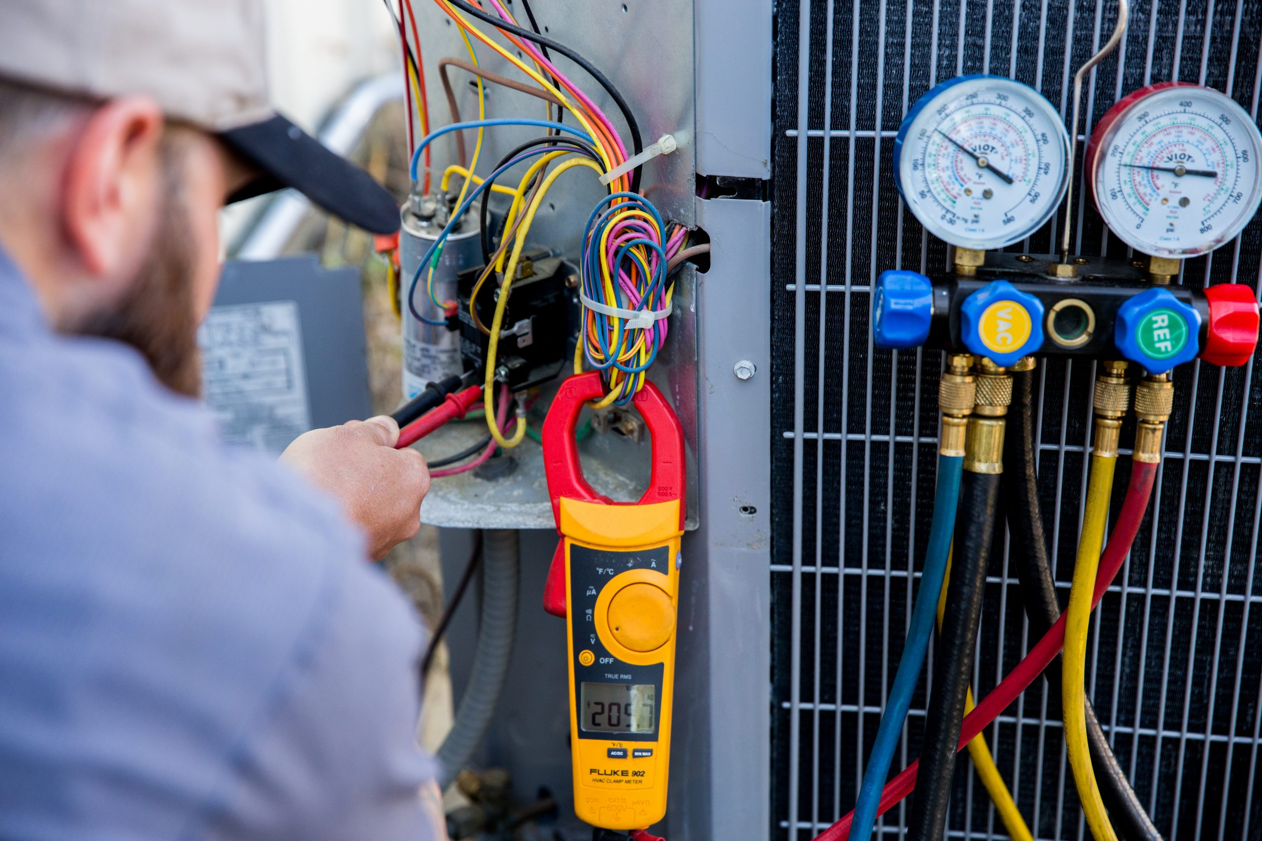 technician inspecting gages on hvac system